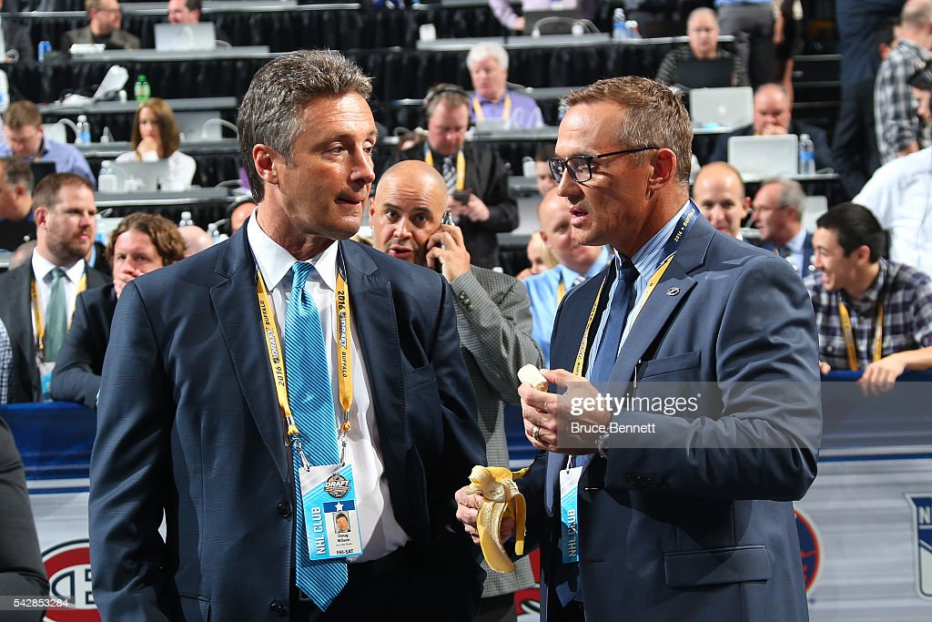 San Jose Sharks General Manager Doug Wilson talks to Tampa Bay Lightning General Manager <a gi-track='captionPersonalityLinkClicked' href=/galleries/search?phrase=Steve+Yzerman&family=editorial&specificpeople=202932 ng-click='$event.stopPropagation()'>Steve Yzerman</a> during round one of the 2016 NHL Draft on June 24, 2016 in Buffalo, New York.