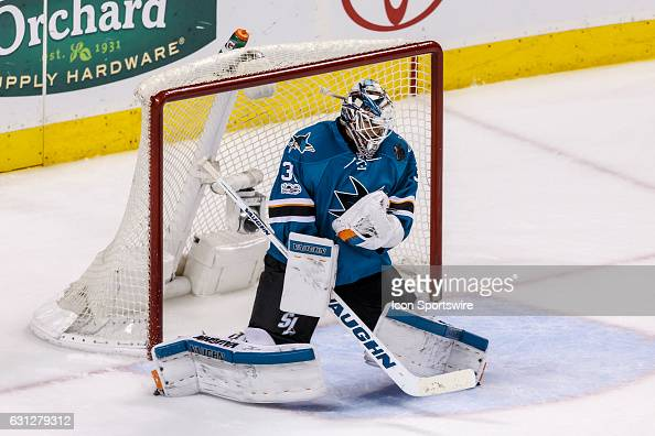 San Jose Sharks goalie Martin Jones makes a save high on his chest protector during the third period of the regular season game between the Detroit...