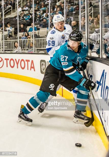 San Jose Sharks Left Wing Joonas Donskoi moves in front of Tampa Bay Lightning Defenceman Jake Dotchin to control the play during the regular season...