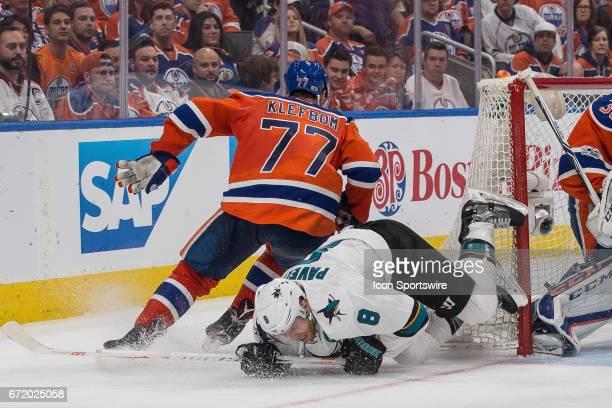 San Jose Sharks Right Wing Joe Pavelski goes down hard onto the ice while Edmonton Oilers Defenceman Oscar Klefbom circles around the Edmonton net on...