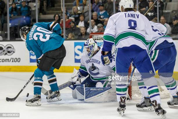 San Jose Sharks right wing Marcus Sorensen fights for the puck in frnt of Vancouver Canucks goalie Richard Bachman during the first period of the...