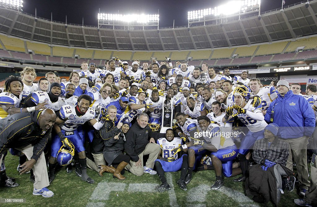 San Jose State poses with the Military Bowl trophy after their game against Bowling Green at RFK Stadium in Washington, Thursday, December 27, 2012. San Jose State defeated Bowling Green 29-20.