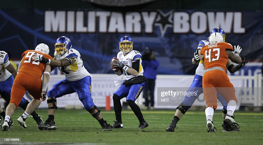 San Jose State quarterback David Fales, center, drops back for a pass against Bowling Green during the third quarter of the Military Bowl at RFK Stadium in Washington, Thursday, December 27, 2012. San Jose State defeated Bowling Green 29-20.