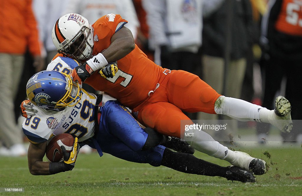 San Jose State wide receiver Chandler Jones (89) is tackled by Bowling Green linebacker Dwayne Woods (5) during the second quarter of the Military Bowl at RFK Stadium in Washington, Thursday, December 27, 2012. San Jose State defeated Bowling Green 29-20.