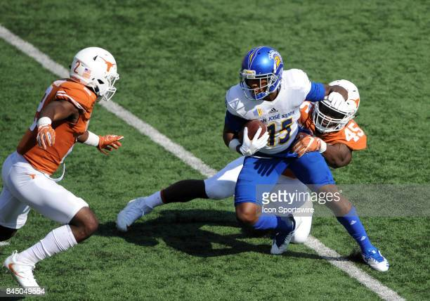 San Jose State WR Tre Hartley is tackled by Texas defenders Anthony Wheeler and Kris Boyd during game between the Texas Longhorns and the San Jose...