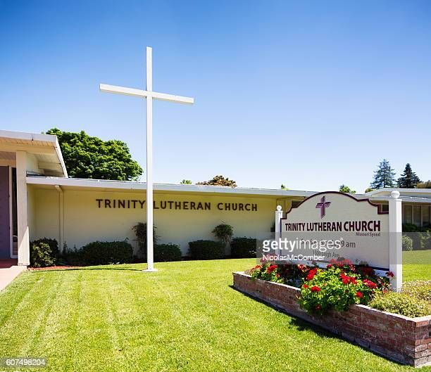 San Jose Trinity Lutheran Church with cross sign and lawn