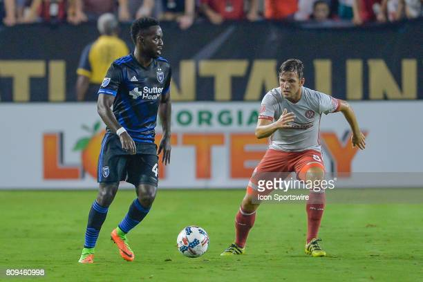 San Jose's Marvell Wynne looks to pass the ball while guarded by Atlanta's Kevin Kratz during a match between the San Jose Earthquakes and Atlanta...