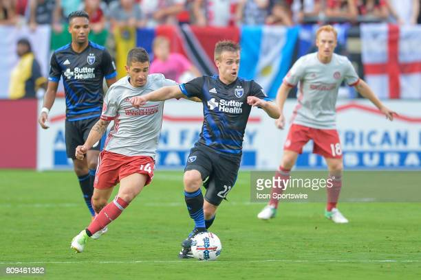 San Jose's Tommy Thompson moves the ball upfield while guarded by Atlanta's Carlos Carmona during a match between the San Jose Earthquakes and...