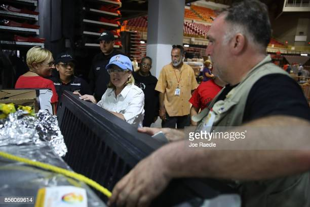 San Juan Mayor Carmen Yulin Cruz and Jose Andres prepare a truck of relief supplies to be sent out from the Roberto Clemente stadium to those in need...
