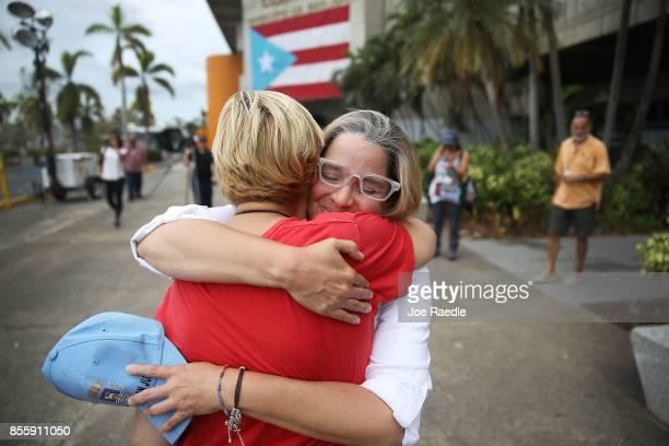 San Juan Mayor Carmen Yulin Cruz hugs Esperanza Ruiz as she arrives at the temporary government center setup at the Roberto Clemente stadium in the...