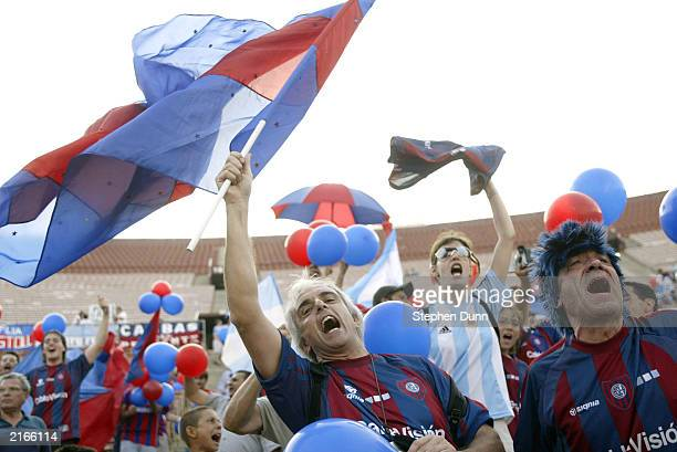 San Lorenzo de Almagro fans cheer their team on against Olimpia in the Recopa final on July 12 2003 at the Los Angeles Coliseum in Los Angeles...