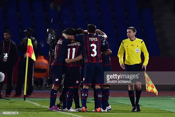 San Lorenzo players celebrate after scoring a goal during the FIFA Club World Cup semifinal football match between San Lorenzo vs Auckland City FC at...