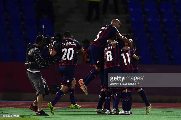 San Lorenzo players celebrate scoring their first goal during the FIFA Club World Cup semifinal football match between San Lorenzo vs Auckland City...