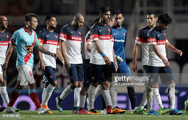 San Lorenzo's footballers leave the field at the end of the half time during their Argentina First Division football match against Arsenal at Pedro...