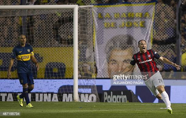 San Lorenzo's forward Mauro Matos celebrates after scoring a goal against Boca Juniors during their Argentina First Division football match at La...