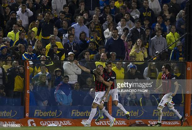 San Lorenzo's forward Mauro Matos celebrates with teammates after scoring a goal against Boca Juniors during their Argentina First Division football...