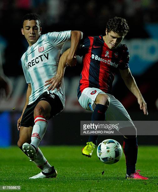 San Lorenzo's midfielder Bautista Merlini vies for the ball with Estudiantes' midfielder Lucas Rodriguez during their Argentina First Division...