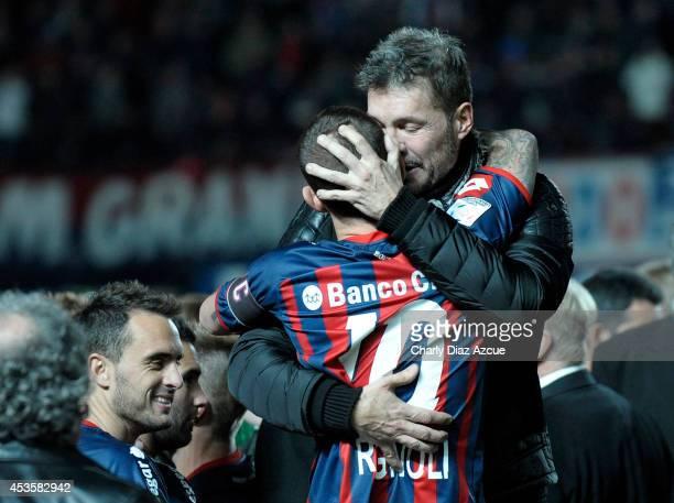 San Lorenzo's Vice President Marcelo Tinelli cheers Leandro Romagnoli after winning the second leg final match between San Lorenzo and Nacional as...