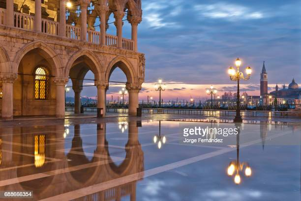 San Marco square flooded by 'Acqua alta' early in the morning