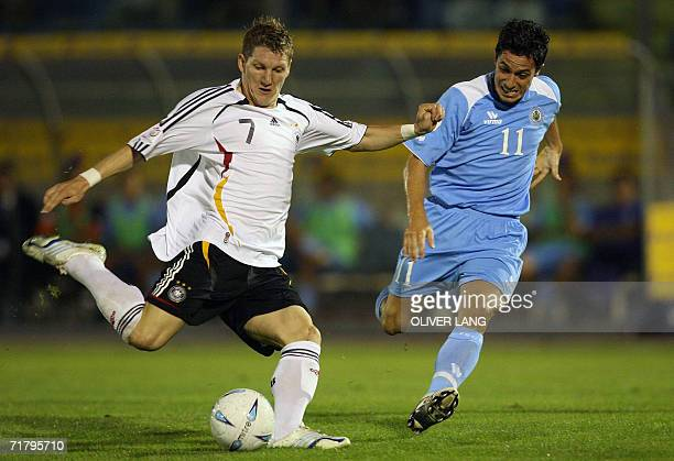 Germany's Bastian Schweinsteiger vies for the ball against San Marino's Marco Domeniconi during their Euro 2008 qualifying football match 06...