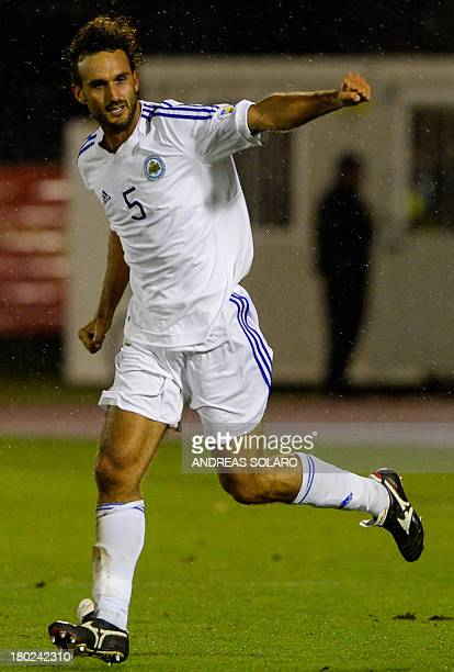 San Marino's defender Alessandro Della Valle celebrates after scoring against Poland during the FIFA World Cup 2014 qualifying football match San...