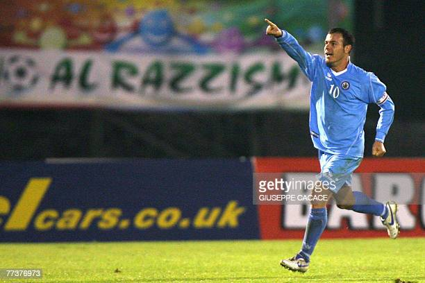 San Marino's forward and captain Andy Selva celebrates after scoing a goal against Wales during their group D Euro 2008 qualifying football match at...