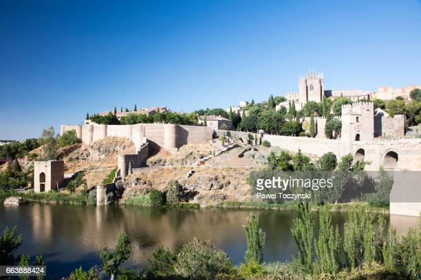 San Martin's medieval stone bridge seen from the opposite bank, Toledo, Spain