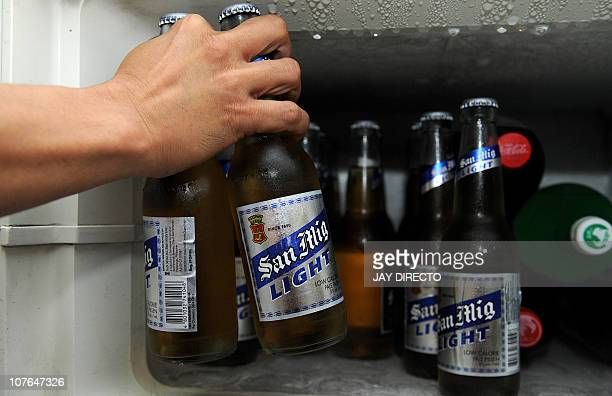 San Miguel beer is displayed in a fridge in Quezon city suburban Manila on December 16 2010 Diversifying Philippine conglomerate San Miguel Corp said...