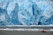 Adventure Tourism. Tourists in a zodiac view the terminus of the San Rafael Glacier in Patagonia in southern Chile in South America.