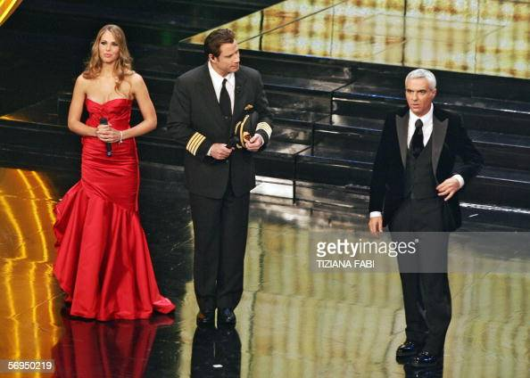 Italian presenter Giorgio Panariello speaks to the audience supported by soccer player Francesco Totti's wife Italian showgirl Ilary Blasi and US...
