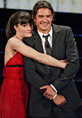 Italian showgirl Victoria Cabello hugs British actor Orlando Bloom on the stage of the Ariston Theatre 03 March 2006 during the 56th Italian music...
