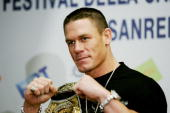 US wrestling champion John Cena raises his fists after a press conference at Ariston Theatre in San Remo during the 56th Italian music festival 02...