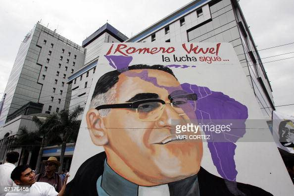 A man looks at a giant poster of Roman Catholic Archbishop Oscar Arnulfo Romero 24 March 2006 during a rally to conmemorate the 26th anniversary of...
