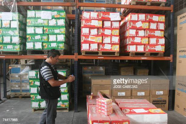 A Salvadorean customs official checks tubes of Chinese tooth paste in a warehouse in San Salvador 06 June 2007 A shipment of 25920 tubes of dental...