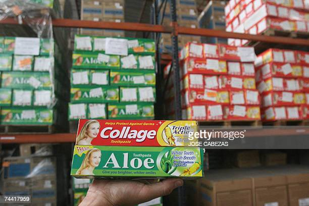 A Salvadorean customs official shows tubes of Chinese tooth paste in a warehouse in San Salvador 06 June 2007 A shipment of 25920 tubes of dental...