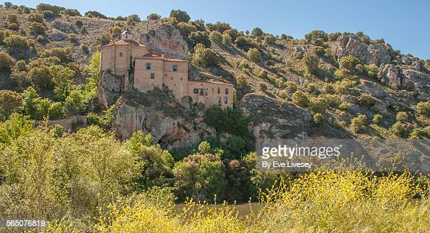 San Santuario Hermitage and yellow wildflowers