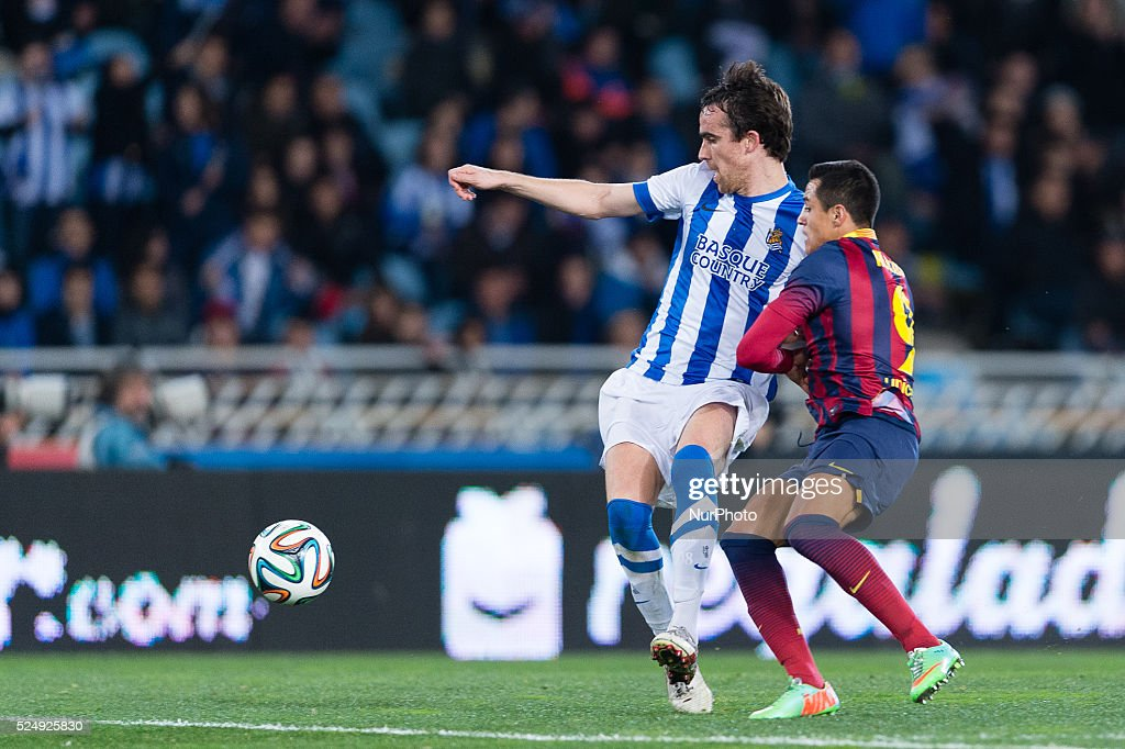 12/02/14 San Sebastian Mikel Gonzalez and Alexis during spanish Copa del Rey soccer semifinal match between Real Sociedad and FC Barcelona played at...
