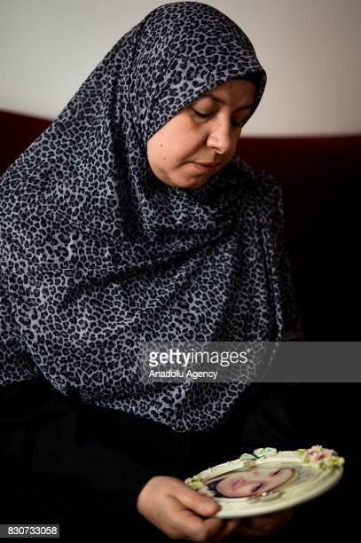 Sana Abdel Gawad mother of Asma Elbeltagy who was killed on Rabaa Massacre when she was 17 holds her daughter's photo in her hands during an...