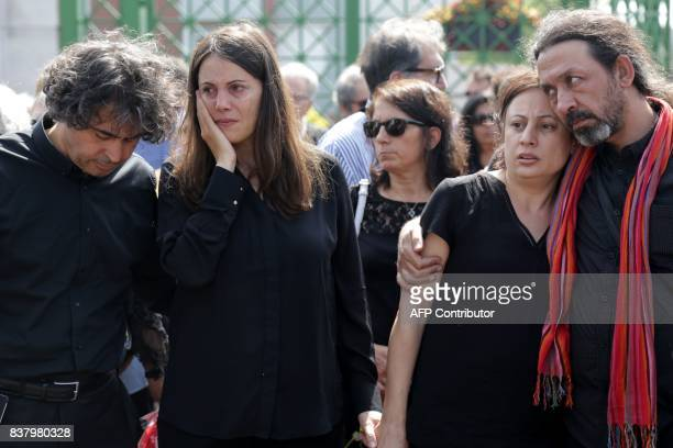Sana and Najat sisters of late Syrian actress and activist Fadwa Suleimane are consoled by their husbands Thaer and Hassan during her funeral in...