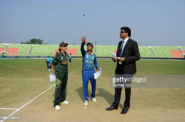 Sana Mir captain of Pakistan Shashikala Sriwardena captain of Sri Lanka and ICC match referee Javagal Srinath during the toss before the start of the...