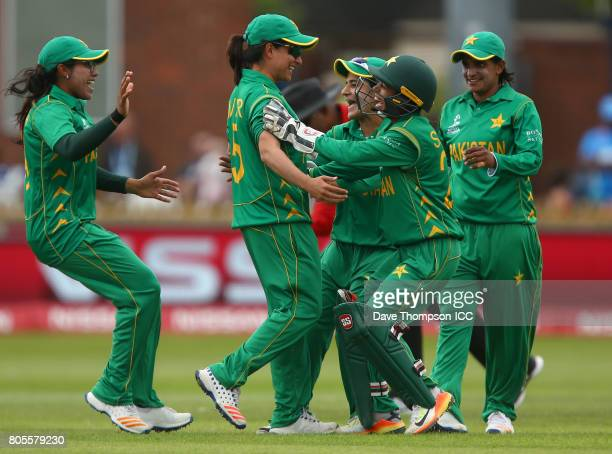 Sana Mir of Pakistan celebrates with team mates after taking a catch to claim the wicket of Harmanpreet Kaur of India during the ICC Women's World...