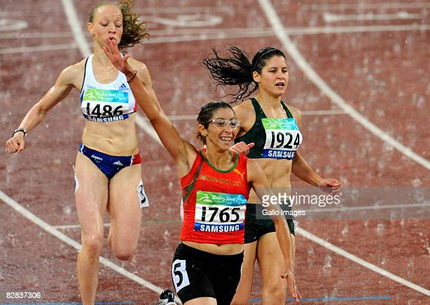 Sanaa Benhama of Marocco wins Gold followed by Ilse Hayes of South Africa coming second in the 100m T13 during day 10 of the 2008 Beijing Paralympic...