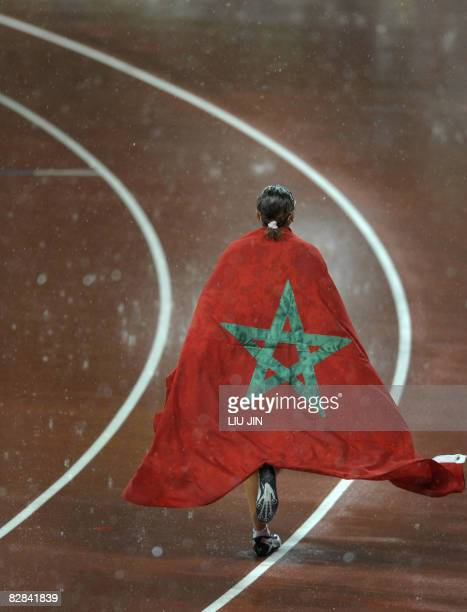 Sanaa Benhama of Morocco celebrates after winning women's 100m T13 during the 2008 Beijing Paralympic Games at the National Stadium in Beijing on...