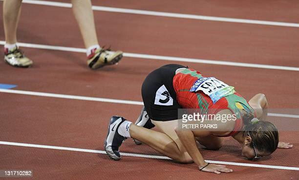 Sanaa Benhama of Morocco celebrates winning gold in the women's 200m T13 final during the 2008 Beijing Paralympic Games at the National Stadium in...