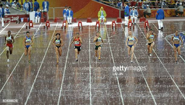 Sanaa Benhama of Morocco competes with other athletes in the women's 100m T13 final during the 2008 Beijing Paralympic Games at the National Stadium...