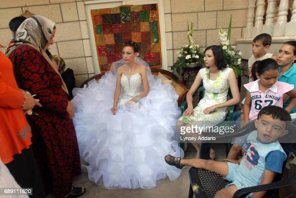 Sanaa Farhat greets friends and family outside of her home during her wedding ceremony of Israeli Arabs in Majd al Kurum village along the Lebanese...