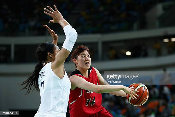 Sanae Motokawa of Japan drives against Maya Moore of United States during the Women's Quarterfinal match on Day 11 of the Rio 2016 Olympic Games at...