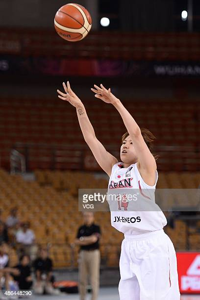 Sanae Motokawa of Japan shoots the ball in semifinal match between Japan and Chinese Taipei during the 2015 FIBA Asia Championship for Women at Wuhan...