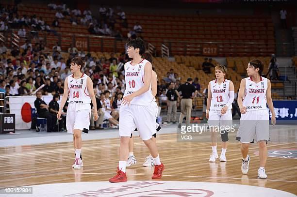Sanae Motokawa Ramu Tokashiki Asami Yoshida and Mio Shinozaki of Japan in semifinal match between Japan and Chinese Taipei during the 2015 FIBA Asia...