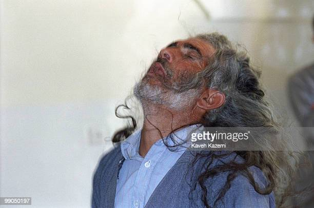 A Kasnazani dervish transcends with his long hair loose in the air during a Remembrence ceremony in a Tekieh in Najar village near Sanandaj in Iran's...